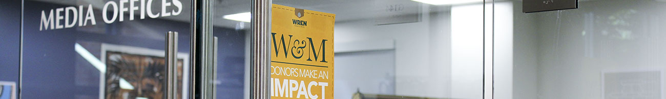 "Gold tag reading ""W&M donors make an impact"" outside the donor funded Reeder Media Center"