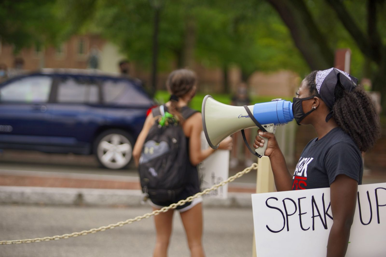 Felecia Hayes '21, coordinator of Black Lives Matter protests with megaphone and poster