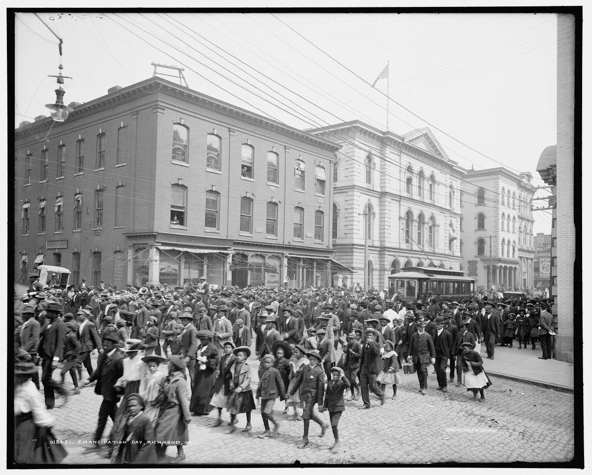 Black and white photograph of African Americans marching down a street in Richmond, Virginia.