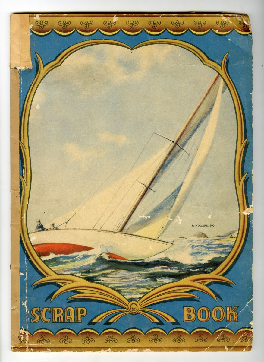 "Cover of Kaemmerle's personal scrapbook, featuring a sailboat at sea with two sailors towards the boat's rear. A blue and gold frame contains the image. Large gold text reads, ""Scrap Book"" toward the bottom of the cover. Small text that reads, ""WINDWARD, HO"" is printed to the right of the sail."