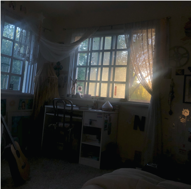 A room at dusk displaying a cozy workspace