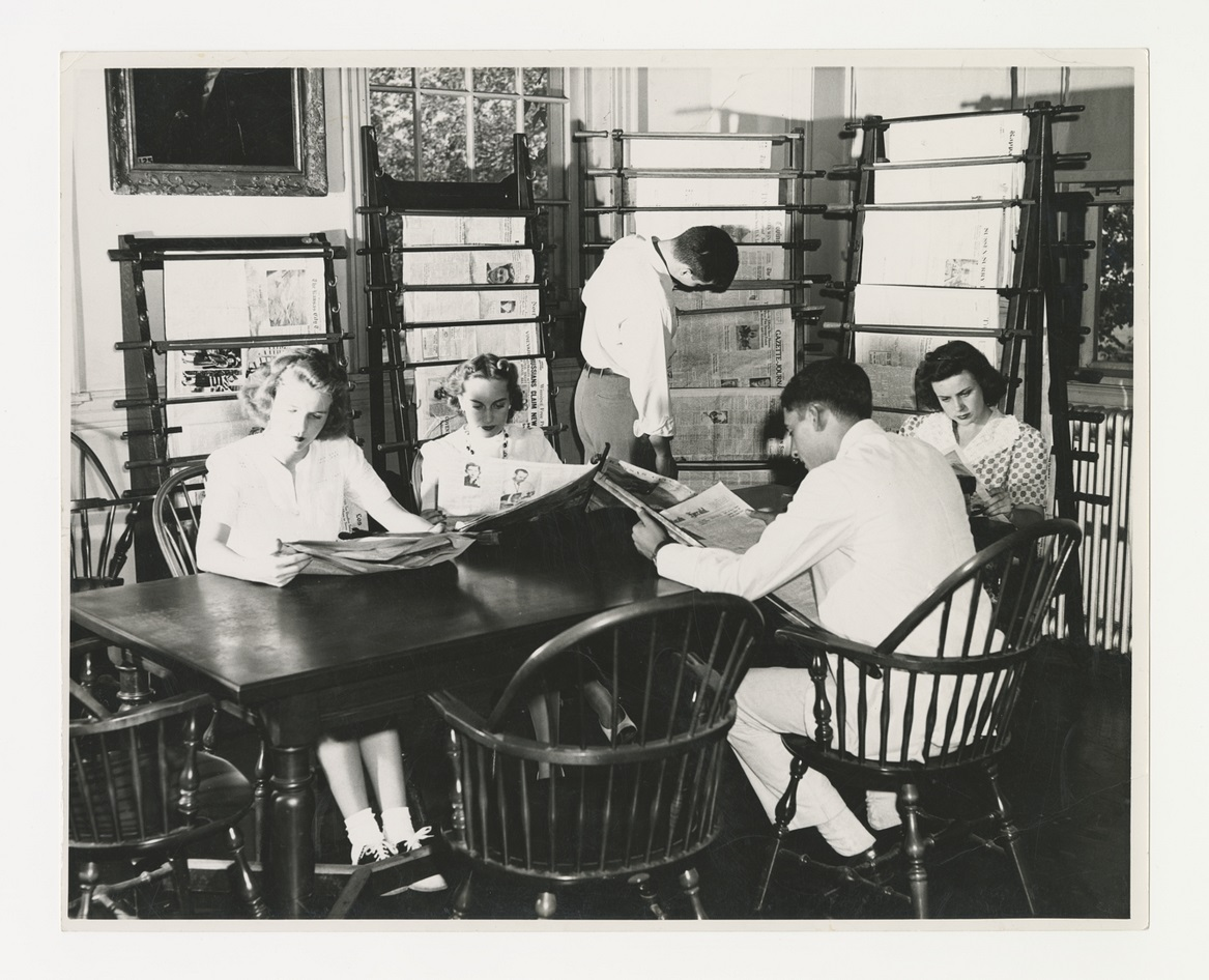 vintage photograph of students sitting around tables in Swem Library