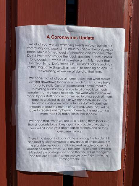 """A photograph of a piece of paper with small unreadable text but a large title that states """"A Coronavirus Update"""""""