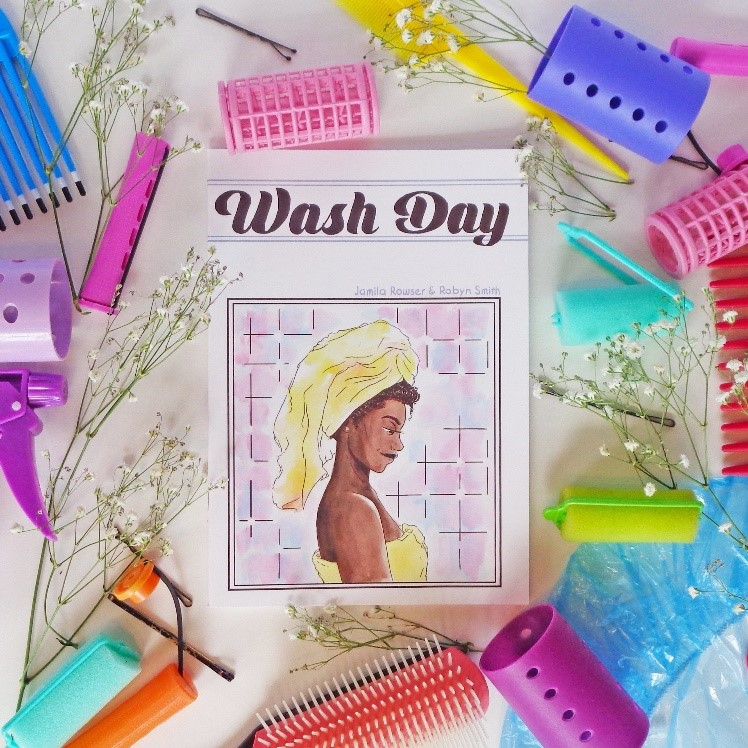 Photograph of the cover of Wash Day, featuring an illustration of a Black woman in the bathroom with a towel around her head. Curl rollers and hair accessories decorate the margins of the photograph.