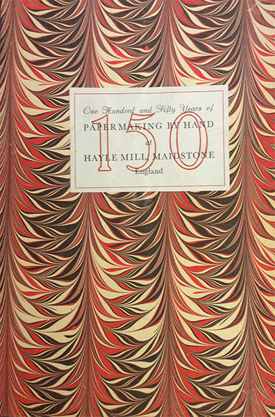 Illustrated cover of book with black, white and red wave pattern.