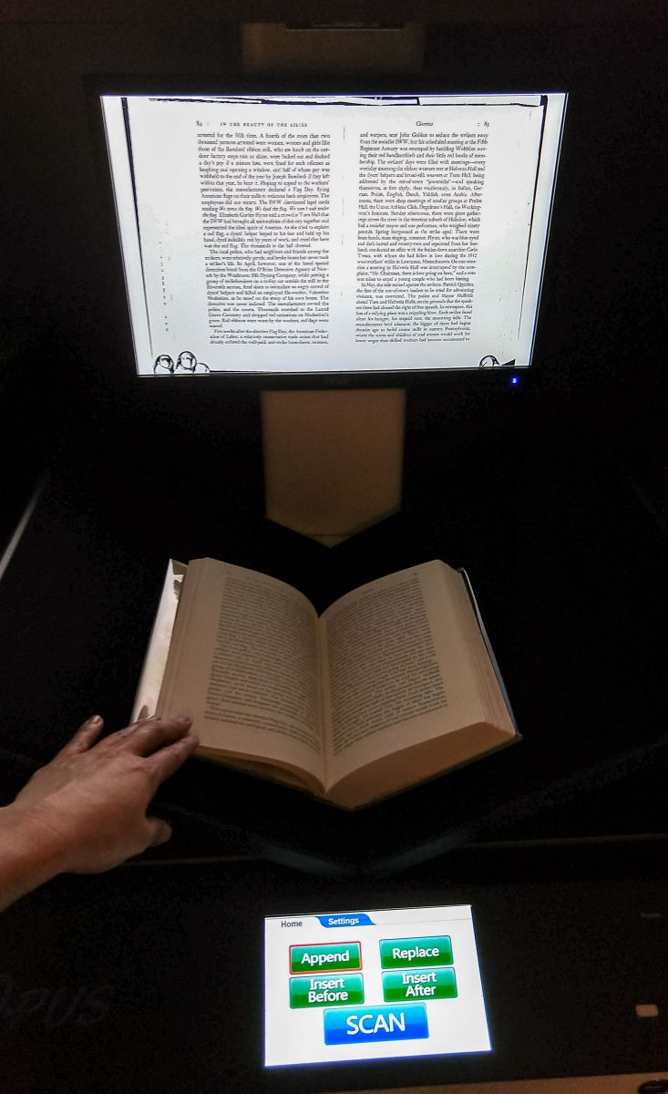 Image of a book being digitized
