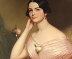 Portrait of young woman in pink dress.