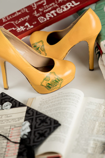 Examples of handmade items including a pair of high heels with the W&M crest