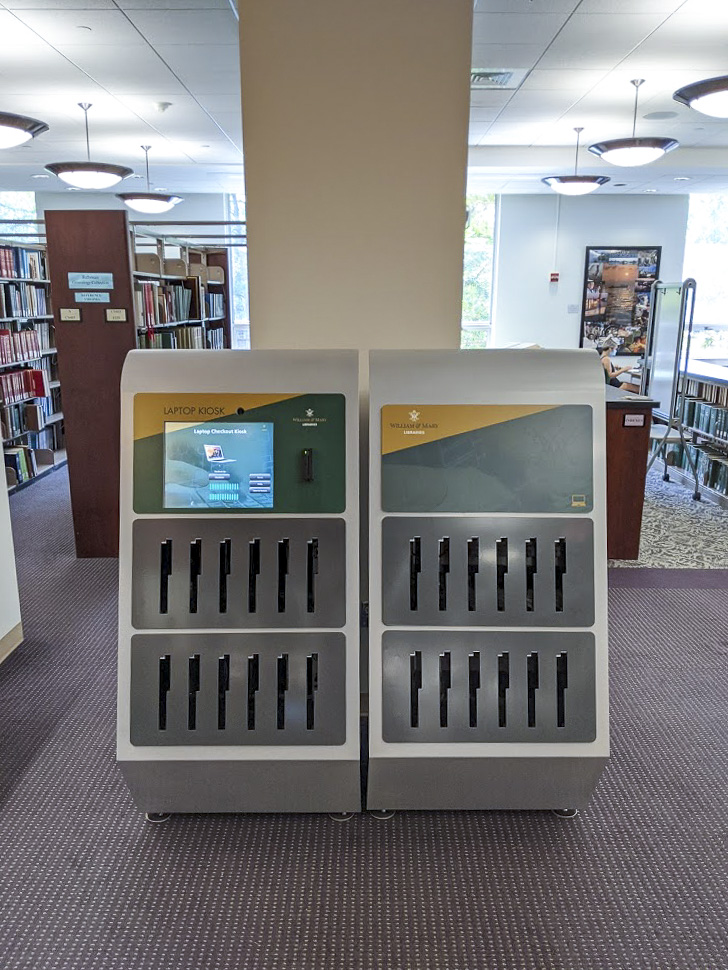 The laptop kiosk located to the left of the Dulin Learning Center. Seating in the Research Room can be seen behind the kiosk.