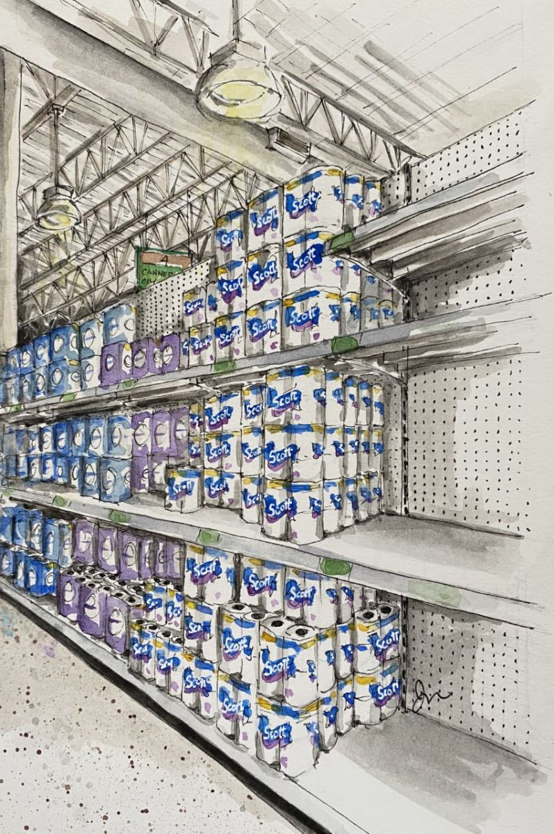 Grocery store aisle filled with paper products.