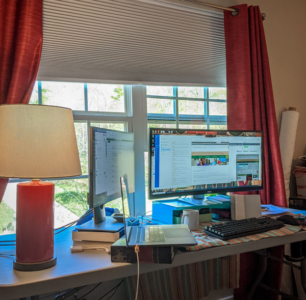work desk set up with two monitors