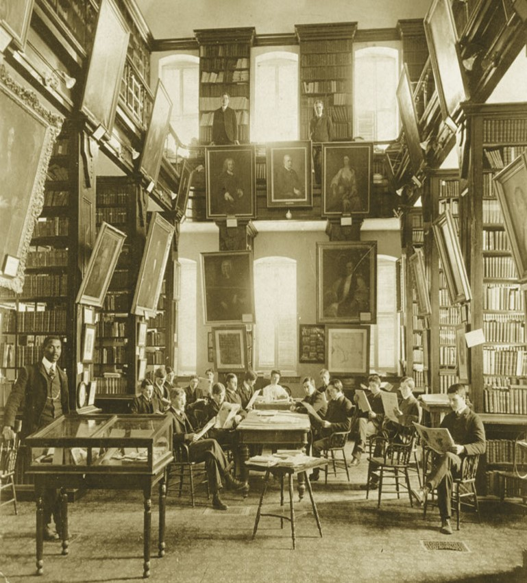 View of the library inside the Wren building with an open two story room filled with windows and shelving.