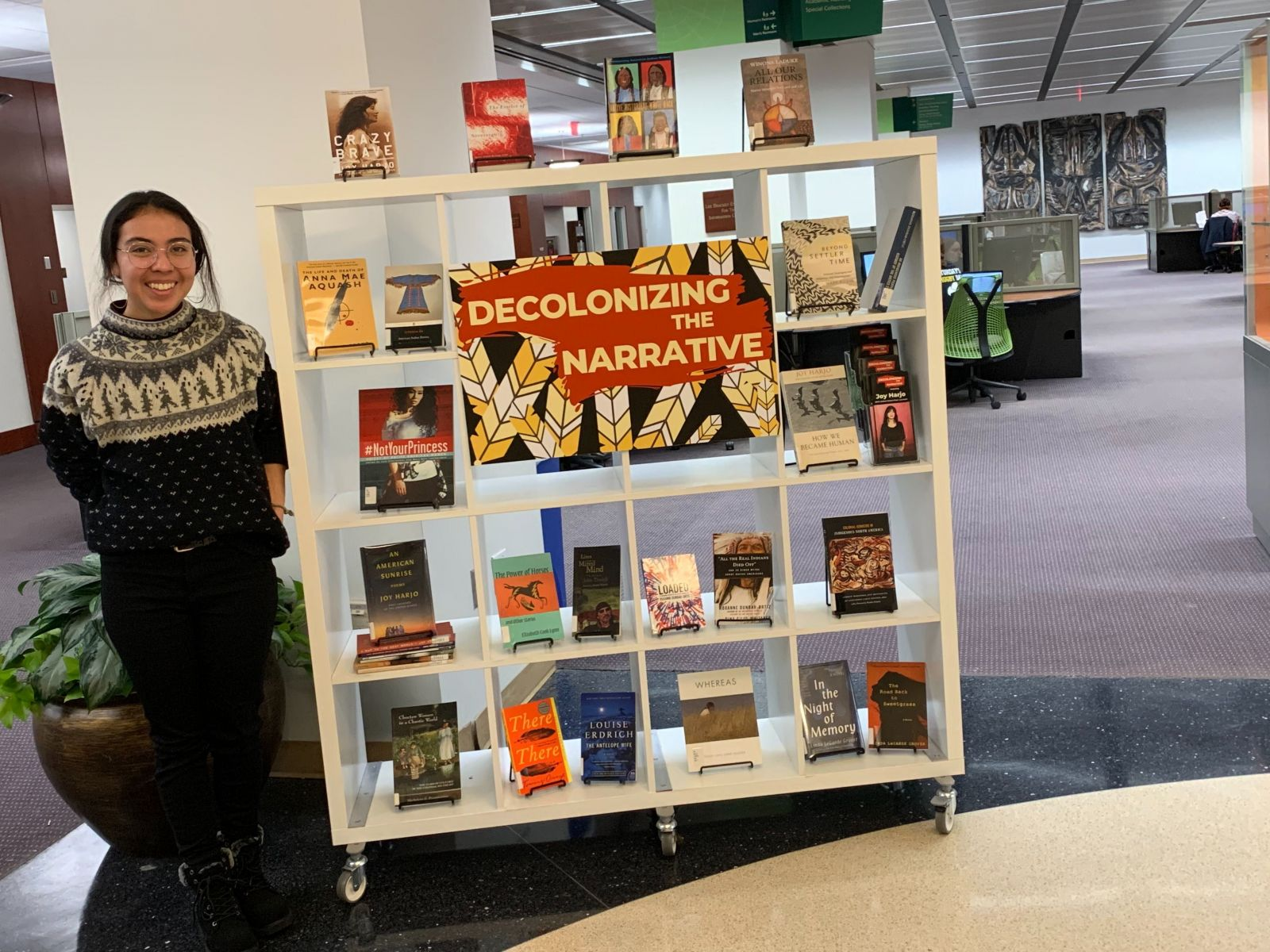yitazba standing by book display
