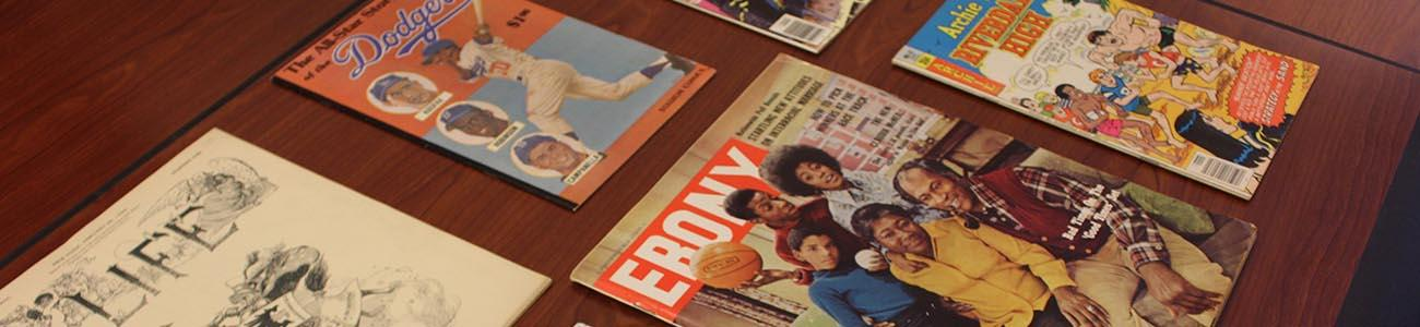 Collection of magazines including Ebony and the Archie comic.