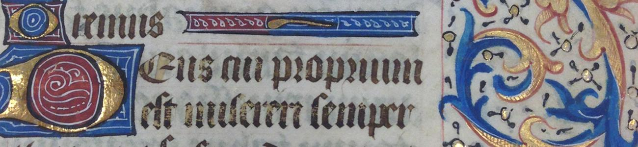 Example of an illuminated manuscript in the collection with blue, red, and gold paint and text.