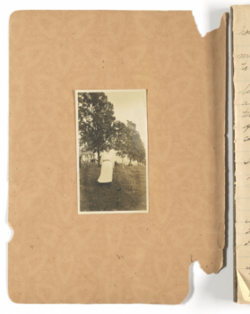 Martha Barksdale's diary, featuring a black-and-white image of a woman, presumably Barksdale, attached to the inside of the front cover.