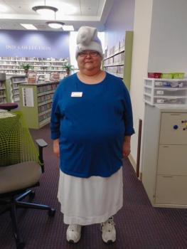 Mildred Sink standing in Swem's Circulation department
