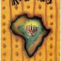 "Exterior and interior of a greeting card, which reads, ""Happy Kwanzaa"" in gold text. A drawing of Africa (colored in shades of green and brown) is in the center of the card. Superimposed on the continent is a fully-lit Kinara."
