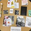 Table covered in zines and other ephemera