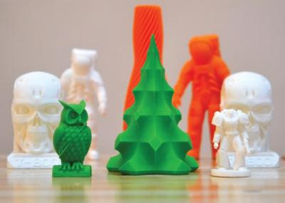 3D printed objects including an owl, tree, and astronaut