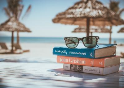 Stack of books on a table at the beach