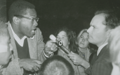 Photograph of Civil Rights demonstrator being interviewed by CBS from Donald L. Mulford Scrapbook