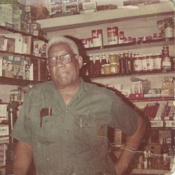 Clarence Webb in his grocery store in Williamsburg Triangle Block